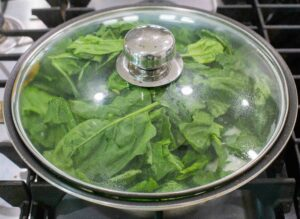 spinach on cover pan