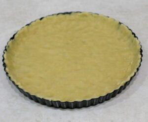 Raw dough on a pie tart