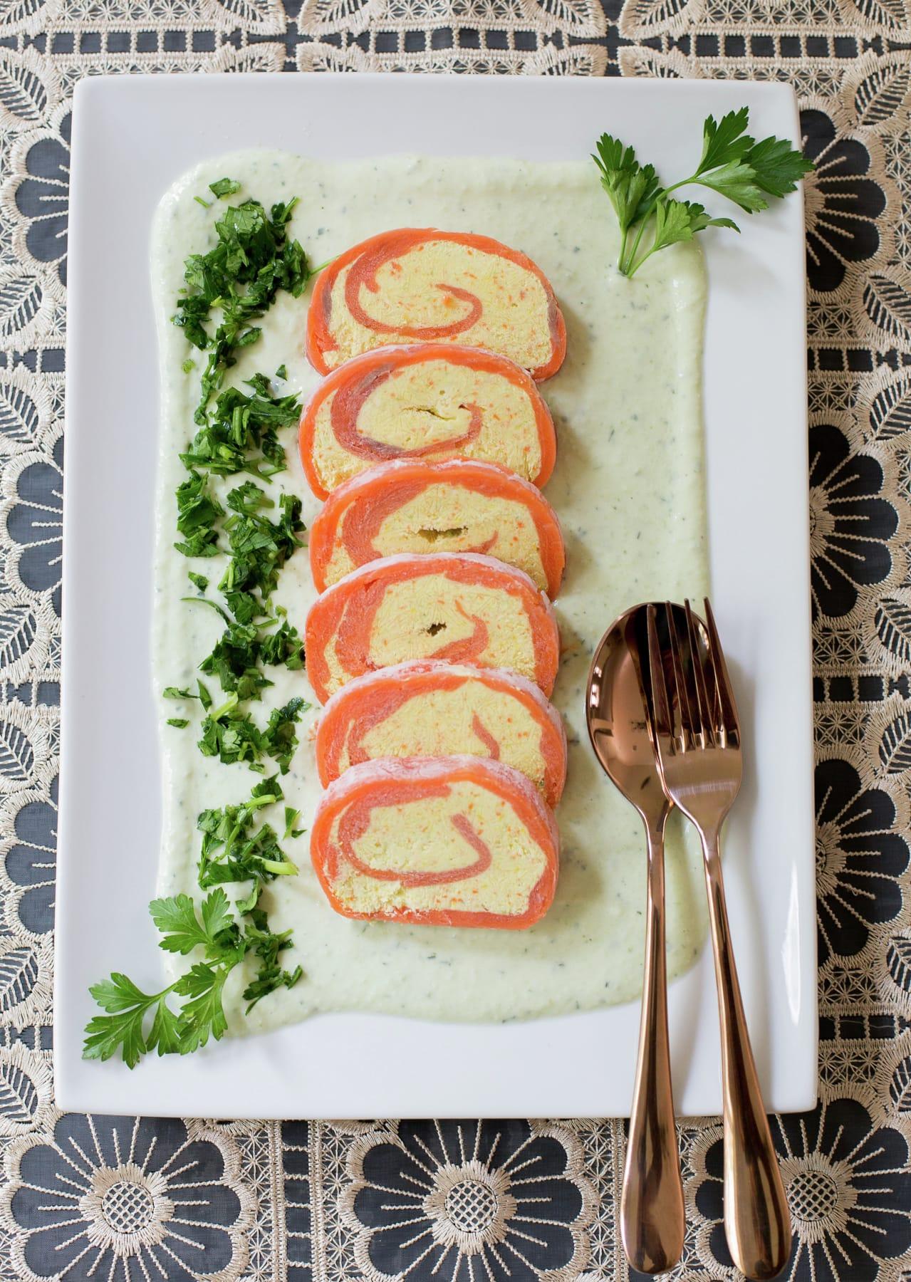 Smoked salmon roulade with cream cheese and avocado cream