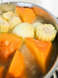 Boil corn and squash