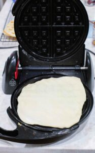 waffle dough on the maker
